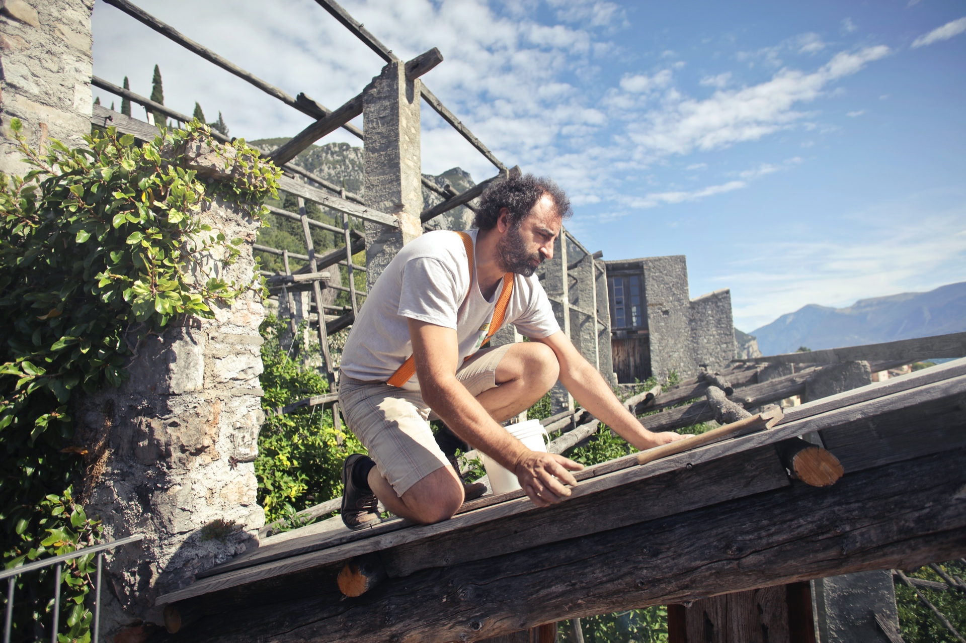 focused-man-building-roof-of-wooden-construction-3771111